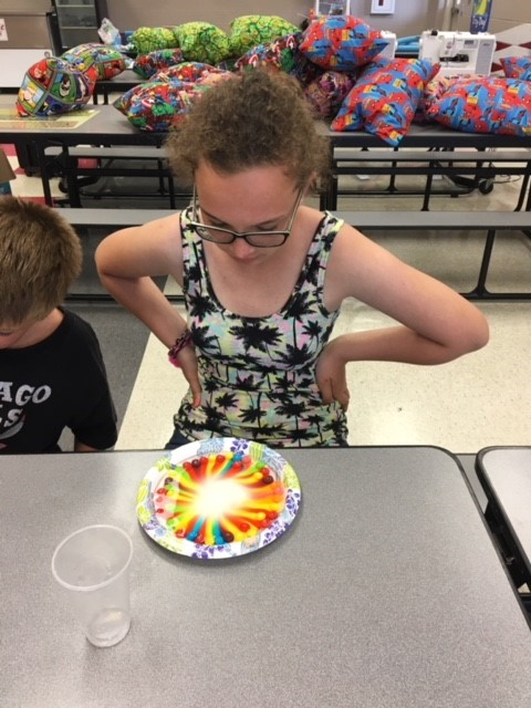 Students do experiments in Science Club!